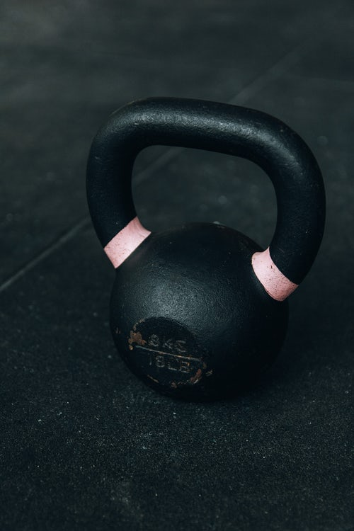Moving gym dumb bells.