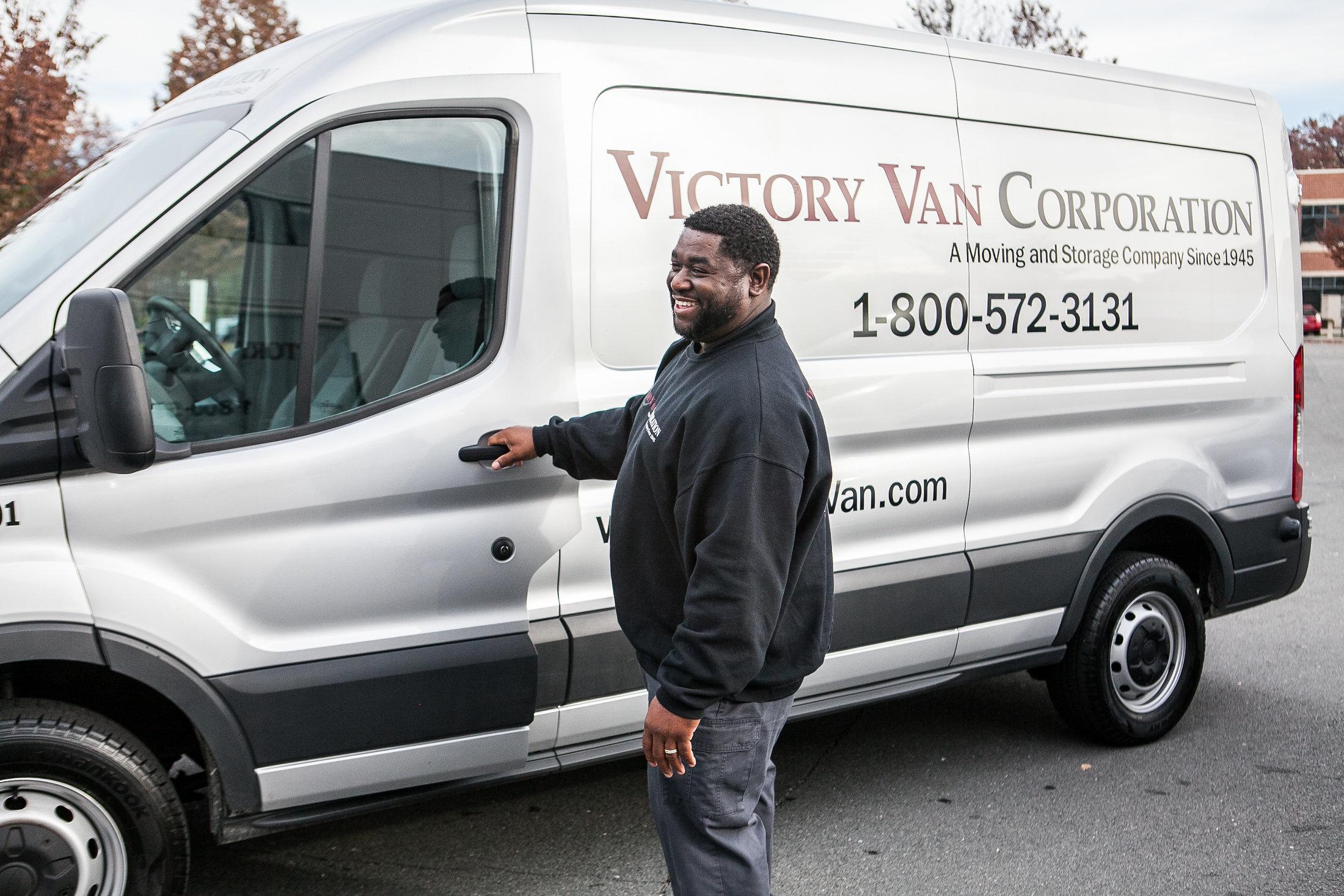 victory van truck and employee
