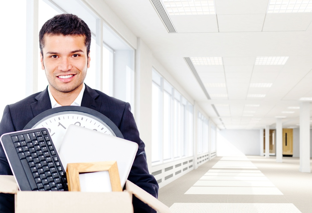 Businessman moving into a new office holding a box